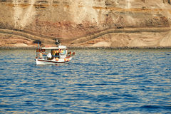Boat near Santorini sea coast Stock Images