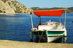 Boat with red tint stock images