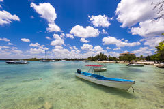 The boat near the shore in Bayahibe, La Altagracia, Dominican Republic. Copy space for text. Royalty Free Stock Photo