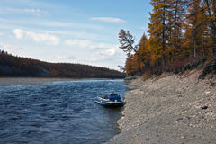 Boat near the shore of the Siberian river Stock Image