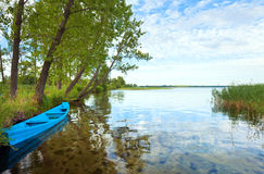 Boat near the summer lake shore. Old wooden fishing boat near the summer lake shore (Svityaz Lake, Ukraine Royalty Free Stock Image