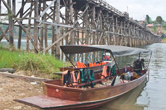 Boat near the wooden bridge Royalty Free Stock Image