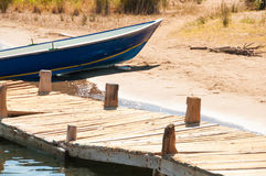 Boat near the wooden bridge Royalty Free Stock Image