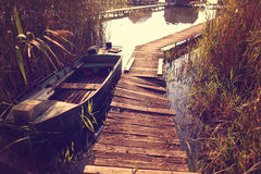 Boat near wooden path on lake Royalty Free Stock Photos
