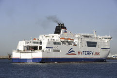 Boat of new company Myferrylink. A ferry boat of new-company Myferrylink enters the port of Calais Stock Photo
