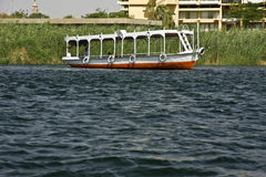 Boat on the Nile. A boat sails on the Nile in Egypt Royalty Free Stock Photos