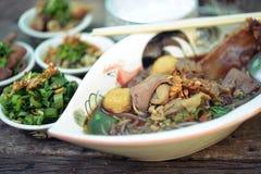 Boat noodles or kuai tiao ruea is a Thai style noodle. Boat noodles Water noodles color like beef noodle soup Stock Image