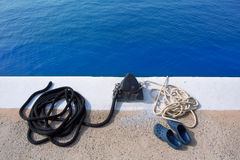 Boat noray marine rope and shoes in marina Stock Photography