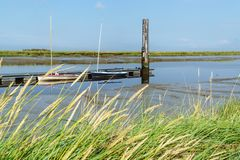 Boat on the North Sea. With blue sky and gras in front Stock Photos