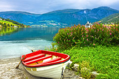 Boat in Norway fjords. Norwegian village Olden. Boat on the beach, Norway fjords. Norwegian village Olden Stock Photos