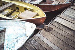 Boat noses and dock close-up Royalty Free Stock Images