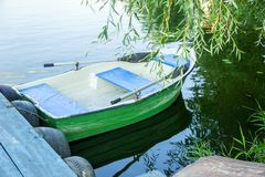Boat with oars. On the lake stock photography