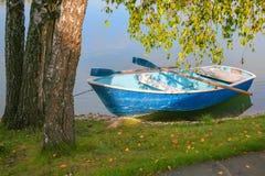Boat with oars near coast Stock Photo