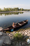 Boat oarsman on river Stock Image