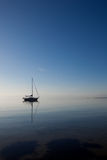 Boat at the ocean. Sail boat in the morning sun in the ocean Stock Photo