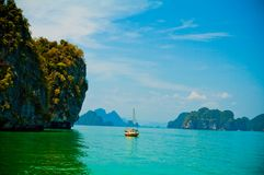 Boat in the ocean against the blue sky. Boat in the middle of the ocean in Thailand royalty free stock photography