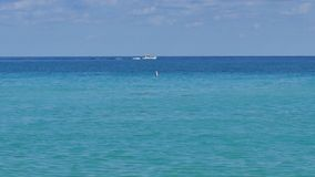 Boat off the coast stock footage