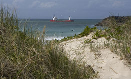 A boat offshore. I climbed the sand dune to see the amazing ocean and a boat offshore royalty free stock images