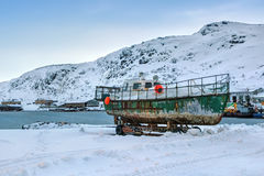 Boat. Old boat in the bay, the fishing village of Teriberka, Murmansk oblast, Kola Peninsula, Russia Stock Images