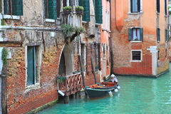 Boat and old brick house in Venice, Italy. Royalty Free Stock Photography