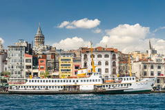 Boat with old buildings and tower in blue sky Royalty Free Stock Photos