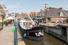Boat by the old lock in Lemmer. Royalty Free Stock Photo