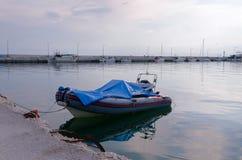Boat at the old pier in Nea Kallikratia, Greece Royalty Free Stock Photo