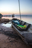 Boat, old, river, calm, blue, water, morning. Stock Image