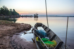 Boat, old, river, calm, blue, water, morning. Royalty Free Stock Images