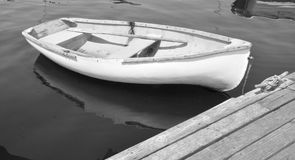 Boat. An old boat tied to the dock somewhere along the Maine Coast. Shown in Black and White stock images