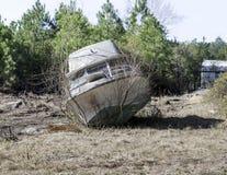 Boat in Open Field. A pleasure boat lies abandoned in an open field near Conway, SC Stock Photography