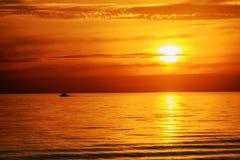 Boat and orange sunset