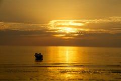 Boat In Orange Waters Stock Image