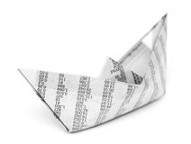 Boat origami from newspaper isolated. On white background stock photos