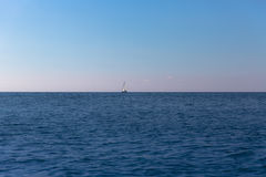 Boat out at sea. Sailing boat out at sea in Montenegro Stock Photos