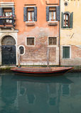 Boat outside buildings in Venice during the day Stock Photography