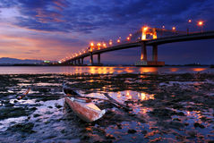 Boat with overlooking bridge. Marcelo Fernan bridge that is found in Cebu city Philippines with lights and lonely boat and blue sky Royalty Free Stock Image