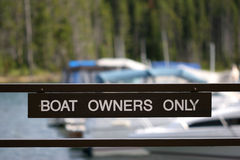 Boat owners only. A sign indicating entry to docks only permitted to boat owners, yellowstone national park Stock Images