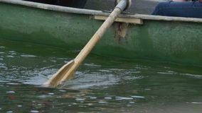 Boat Paddle on Lake stock video