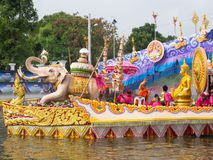 Boat parade of LP Toh BangPlee. SAMUTPRAKRAN - OCTOBER 17: The boat parade of Luang Phor Toh buddha image in Lotus Receiving Festival (Rub Bua Festival) Royalty Free Stock Images
