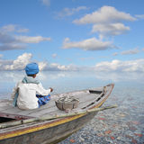 Boat in the paradise. Fisherman working in his boat on the sea Stock Images