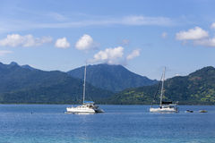 Boat at Paradise Tropic Island. Royalty Free Stock Photo