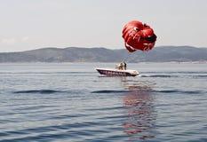 Boat parasaling in Croatia Royalty Free Stock Photos