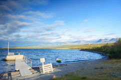 Boat park near lake in Abisko national park in the north of Sweden under blue sky Royalty Free Stock Images