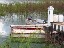 Boat parked in a big swamp royalty free stock photo