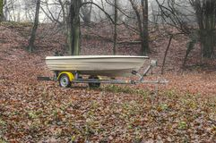 A boat parked in a forest. Speedboat parked in the middle of a forest royalty free stock photography