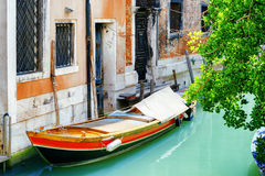 Boat parked beside old house on Rio de S. Cassan Canal, Venice Royalty Free Stock Images