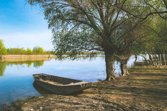 Boat Parked on River Shore Under the Tree. Boat Parked on River Shore Stock Photos