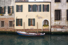 Boat parking in front of old facade building Stock Photo