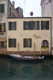 Boat parking in front of old facade building Stock Images